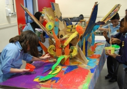Look Out public art trail - children from Hungerford Primary School painting the second giant pop-up insect